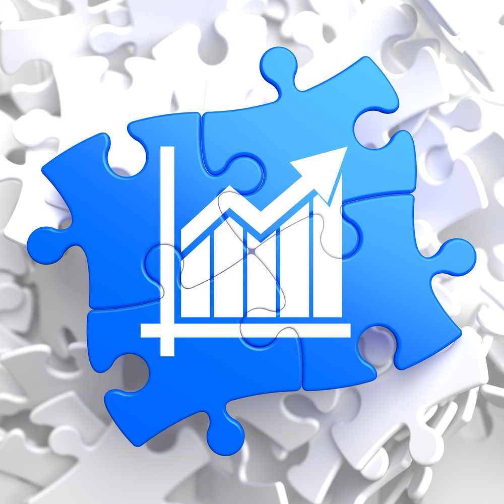 Growth Chart Located on Blue Puzzle Pieces. Business Concept..jpeg